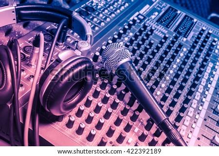 microphone,headphones,sound mixer music background. - stock photo