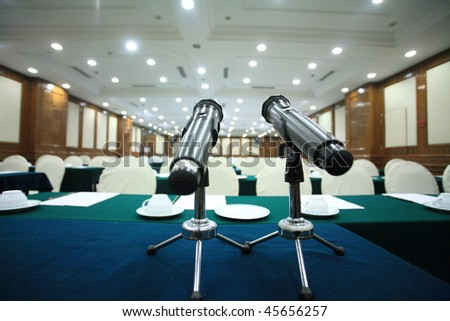 microphone in a big conference hall - stock photo