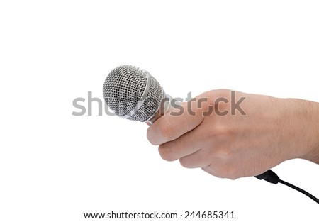 microphone in a hand - stock photo