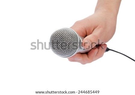 microphone in a hand the isolated - stock photo