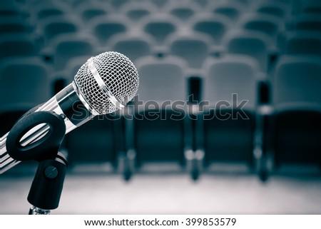 Microphone in auditorium - stock photo