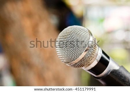 Microphone in blurred background.