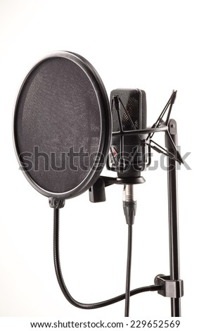 Microphone in broadcasting station isolated on white - stock photo