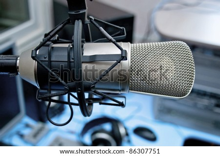 Microphone in broadcasting studio - stock photo