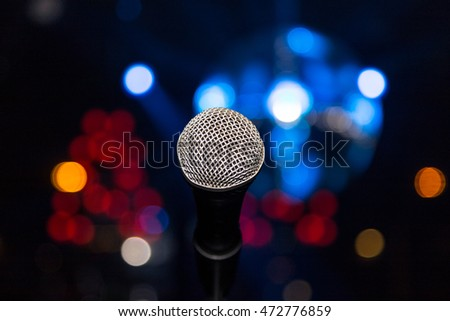microphone in club on background of a bright colored lights