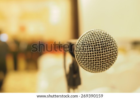 Microphone in concert hall or conference room with blurry background. Extremely shallow dof.