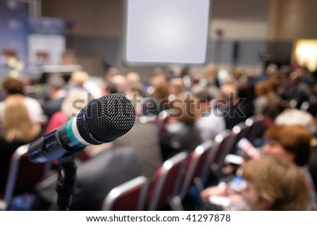 Microphone in conference hall. - stock photo