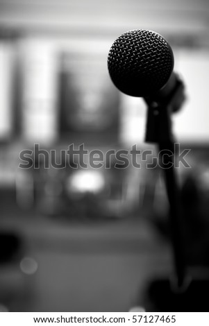 Microphone in conference room. Head detail - stock photo