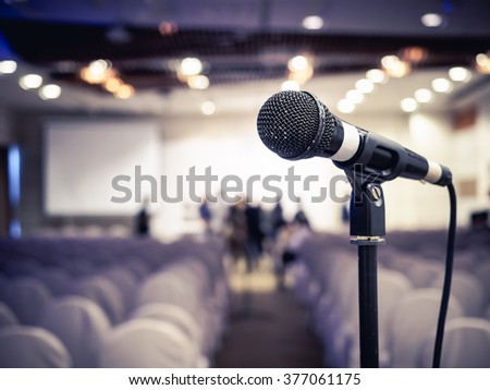 Microphone in Conference Seminar room Meeting Event Background - stock photo