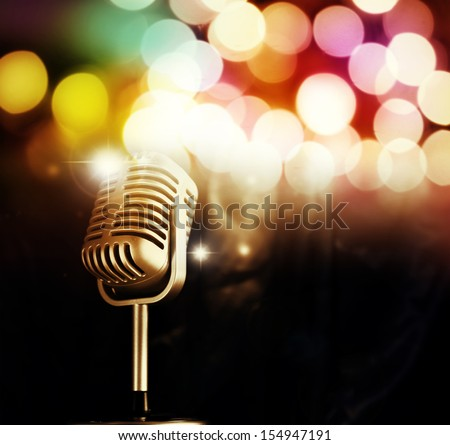 Microphone in front of bright lights - stock photo