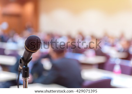 Microphone in meeting room for a conference. - stock photo