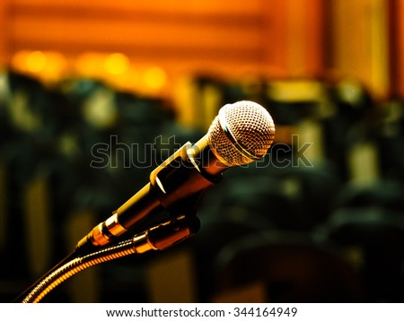 microphone in meeting room or conference room with blurred light background - stock photo