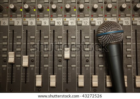microphone in old dirty sound mixer panel - stock photo
