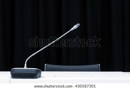 Microphone in press conference room. Monochrome indoors picture  - stock photo