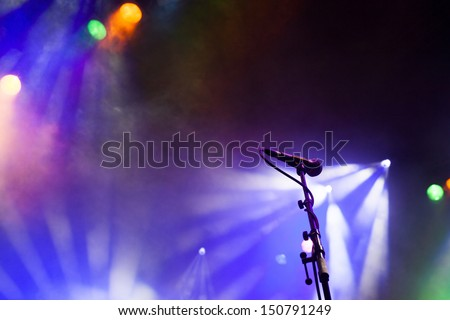 Microphone in stage lights - stock photo