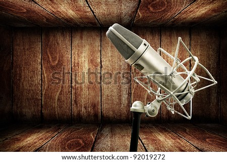 Microphone in wooden studio, Music concept - stock photo