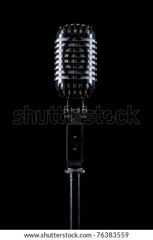 Microphone isolated on black background - stock photo