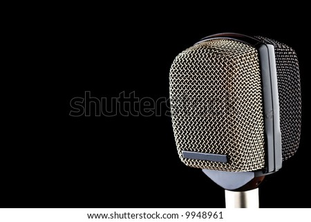 Microphone isolated on black background