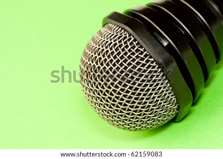 Microphone isolated on green background - stock photo