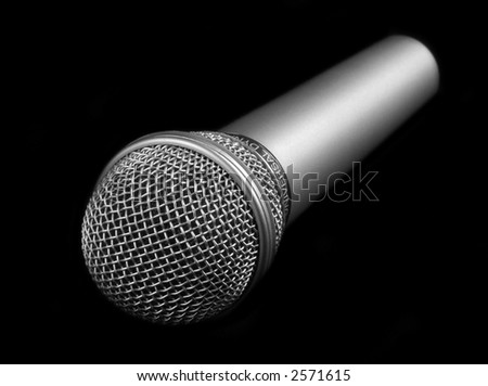 microphone on a black background - stock photo