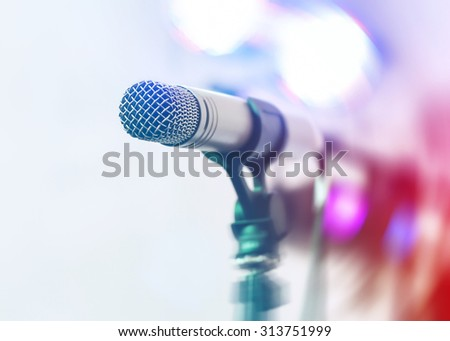 Microphone on a bokeh background - stock photo