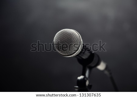 Microphone on a dark background - stock photo