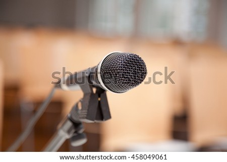 Microphone on a stand at a presentation or speech.