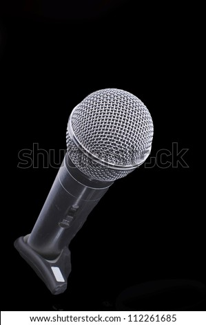 microphone on a stand on black background
