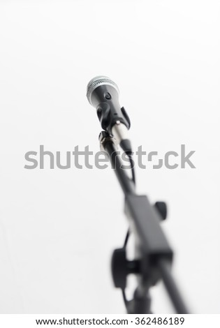 Microphone on a stand with shallow depth of field - stock photo