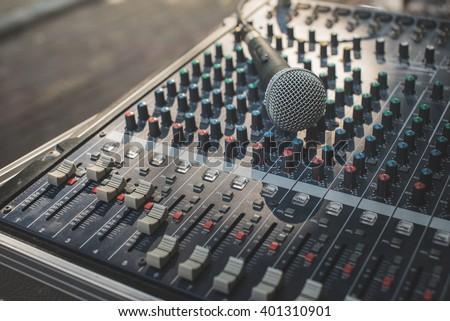 microphone on audio mixer's  - stock photo