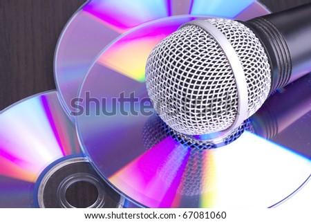 Microphone on cd discs, closeup - stock photo