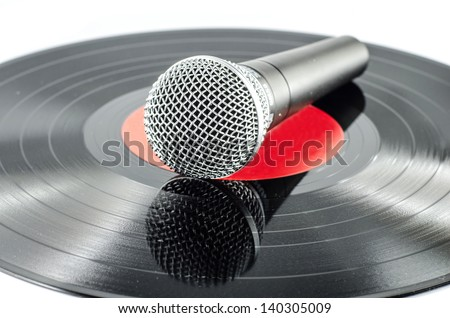 Microphone on old disc isolated on  white background - music concept - - stock photo