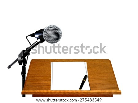 Microphone on podium with blank paper and pen - stock photo