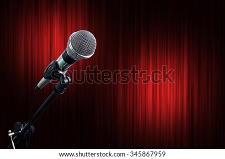 Microphone on Red Curtain Stage Background with light spots