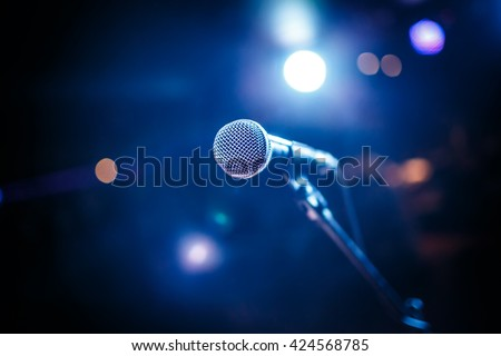 Microphone on stage against a background of auditorium - stock photo