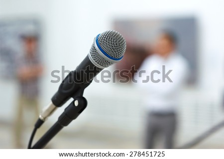 microphone on stage in front of the crown - stock photo