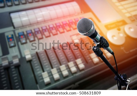 microphone on stand in front of sound mixer device