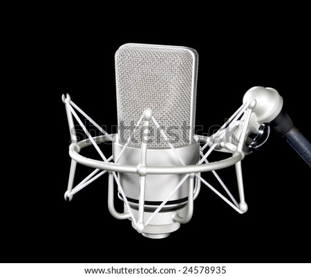 Microphone on stand isolated on black - stock photo