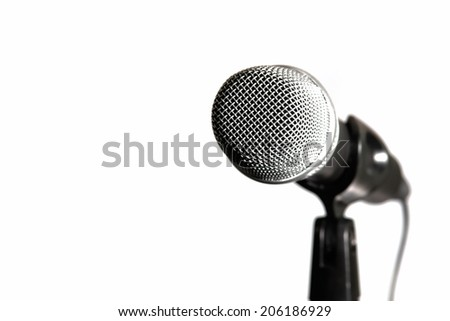Microphone on stand with cable isolated on white.