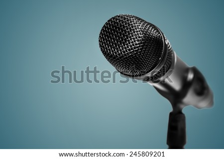 Microphone  on the blue background. - stock photo
