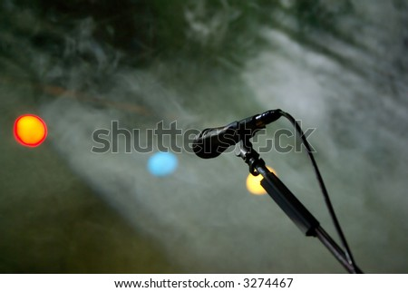 Microphone on the stage spotlights and fog - stock photo