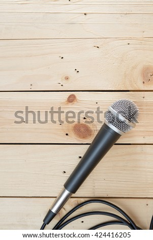 microphone on wooden background - stock photo
