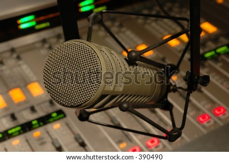 Microphone over an audio console - stock photo