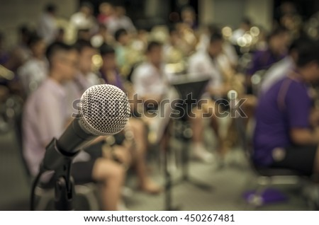Microphone over the Abstract blurred photo of classic music band when rehearsal, musical concept, seminar meeting concept
