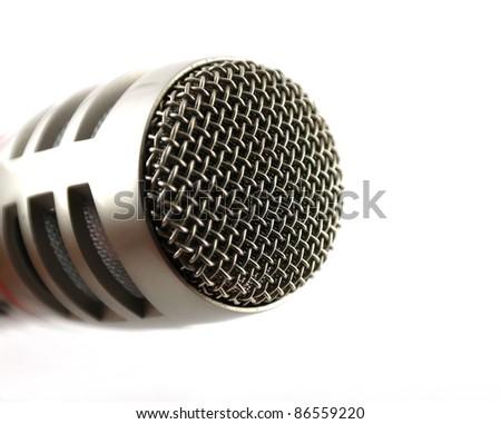 Microphone over white. Closeup. Shallow DOF. - stock photo
