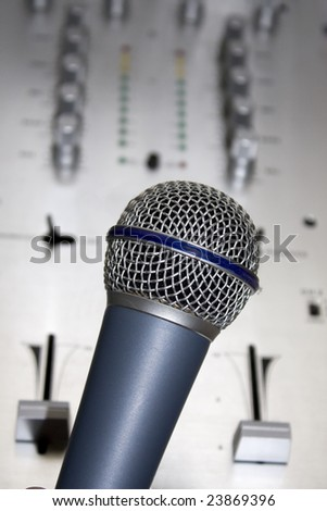 Microphone with audio mixer in background