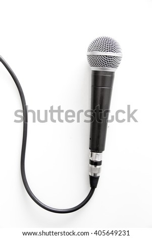 Microphone with cable on a table - stock photo