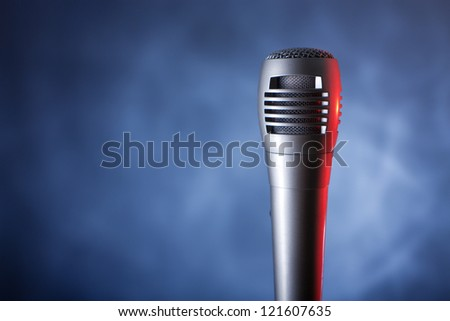 microphone with copyspace on the dark background