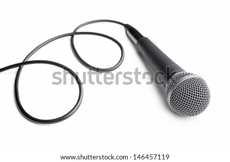 Microphone with curly cable on white background - stock photo