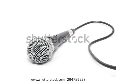Microphone with its cable. - stock photo